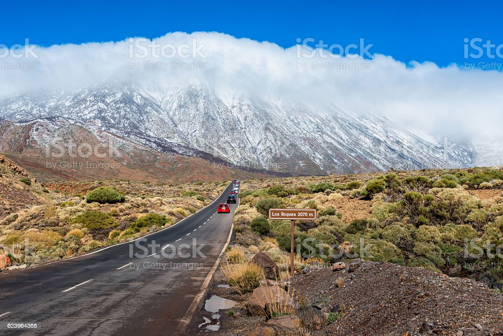 Cars driving on road in Teide National Park Tenerife stock photo