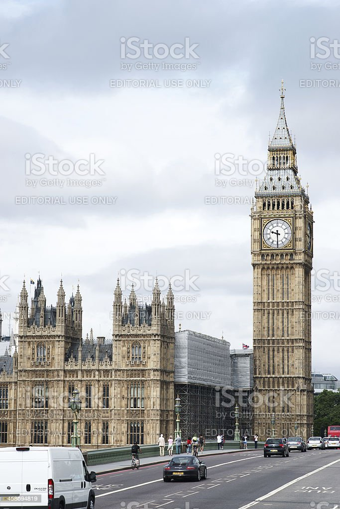 Cars driving over Westminster Bridge towards Houses of Parliament royalty-free stock photo
