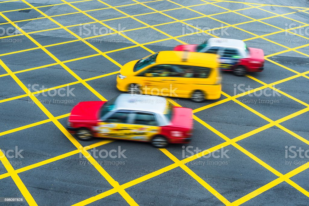 cars driving through no parking area stock photo