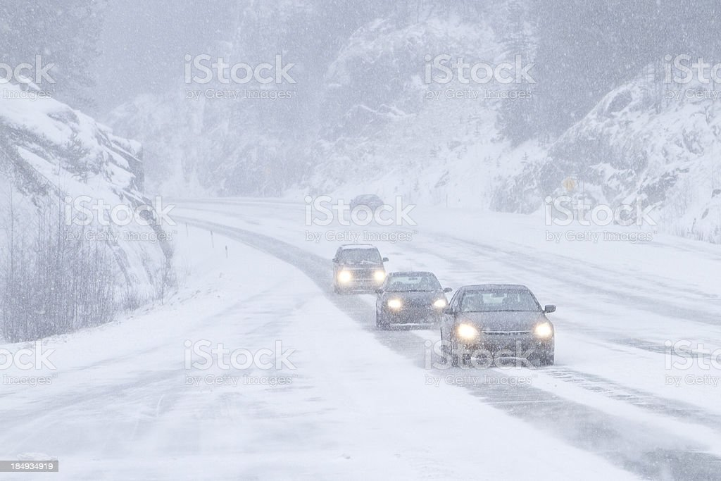 Cars driving through the storm. stock photo