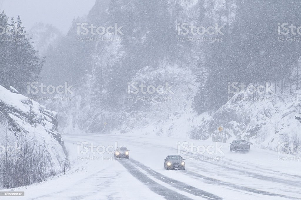 Cars driving through the storm. royalty-free stock photo