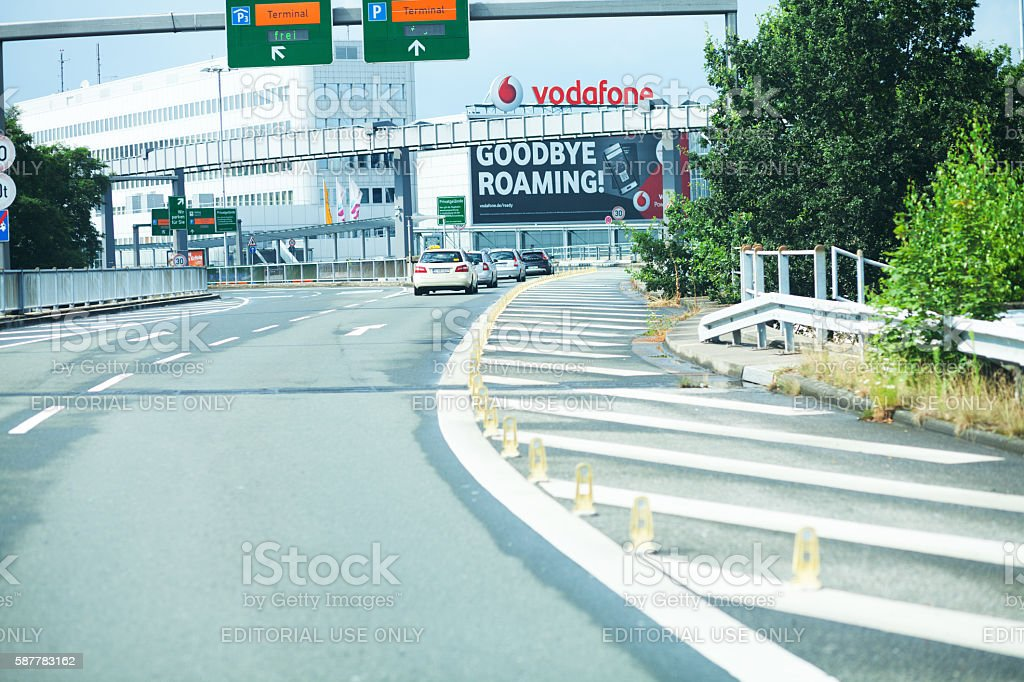 Cars driving to derparture hall of airport Düsseldorf stock photo