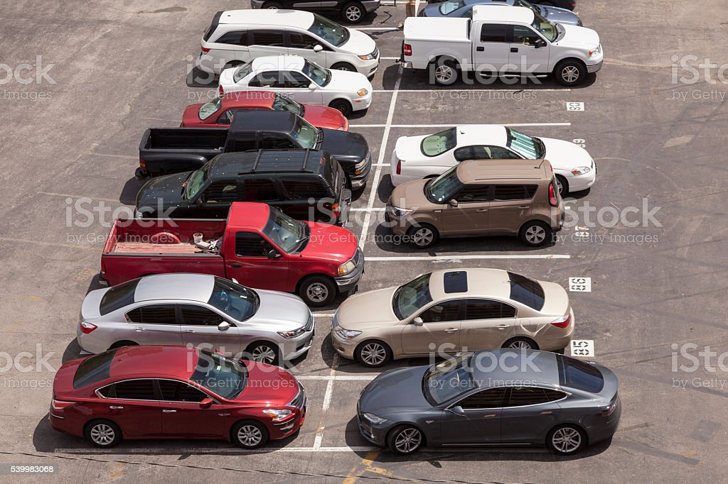 Cars in a parking lot stock photo