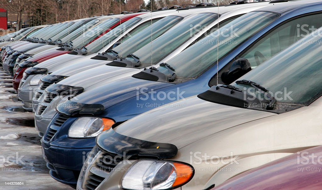 Cars in a row at a car dealership stock photo
