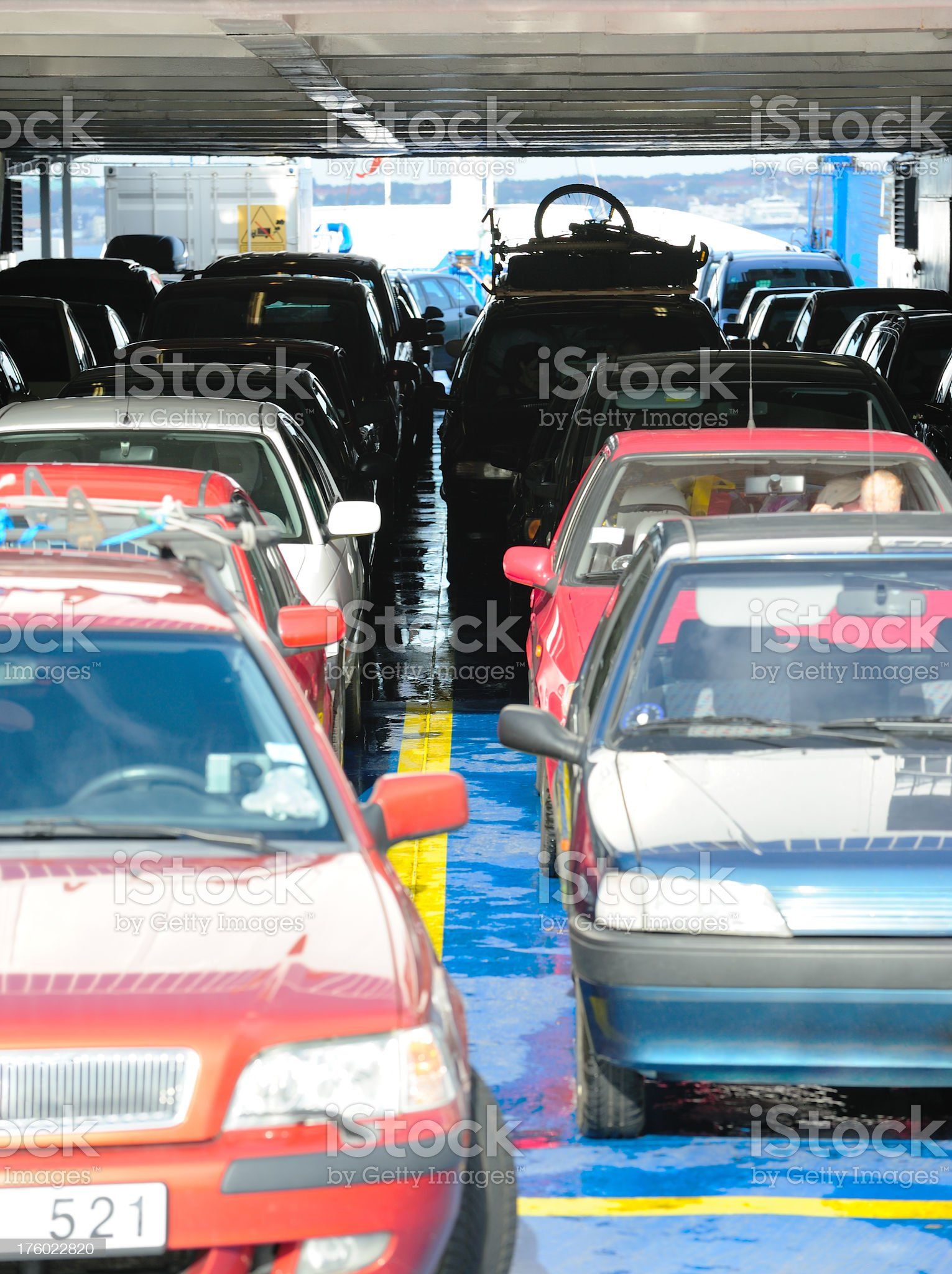 Cars in line on ferry ready to exit royalty-free stock photo