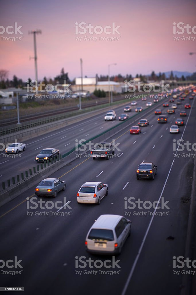 Cars in Rush Hour Traffic at Sunset stock photo