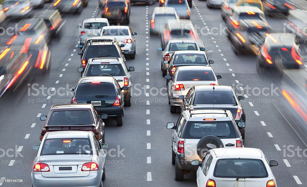 Cars in rush hour with traffic at dawn stock photo