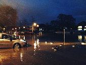 Cars in spring tide flood of River Thames in Twickenham