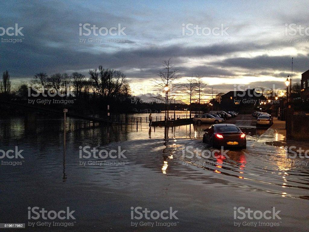 Cars in spring tide flood of River Thames in Twickenham stock photo