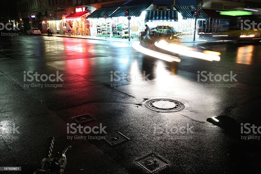 Cars in the night on a wet street royalty-free stock photo
