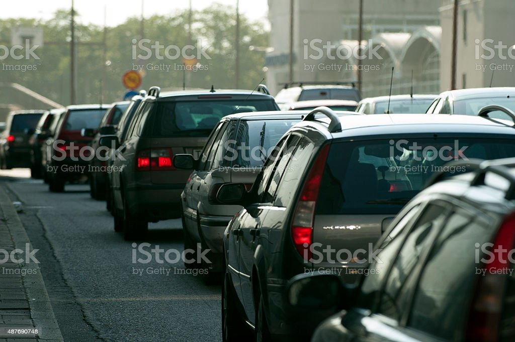 cars in traffic jam in a city during rush hour stock photo