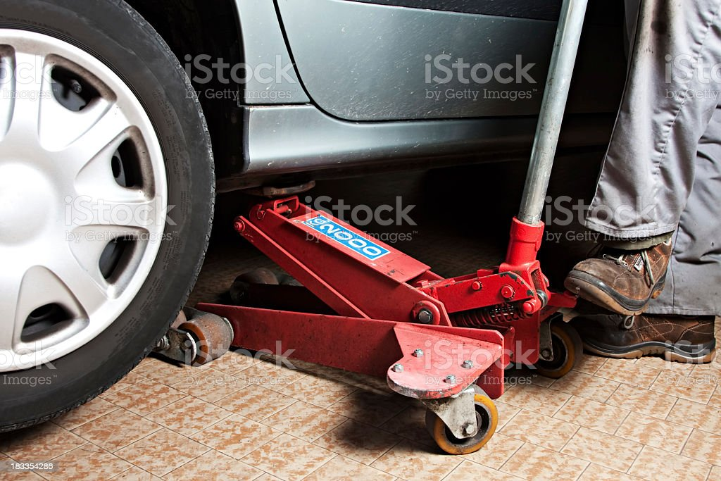 cars lifted off the ground stock photo