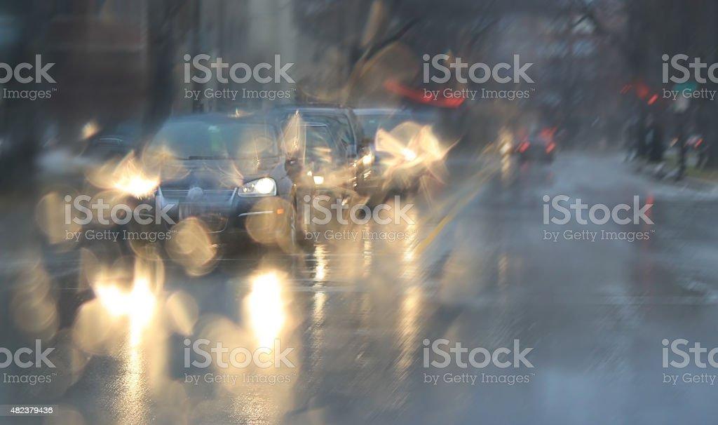Cars, lights and rain. stock photo