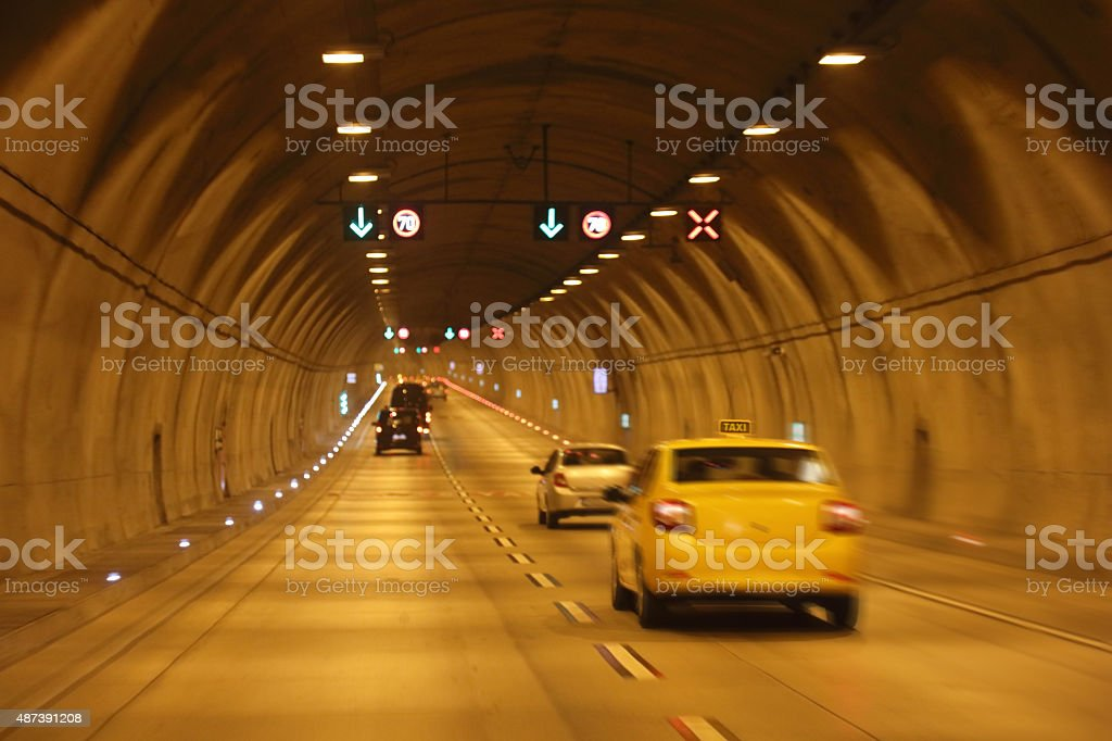 cars moving in tunnel stock photo