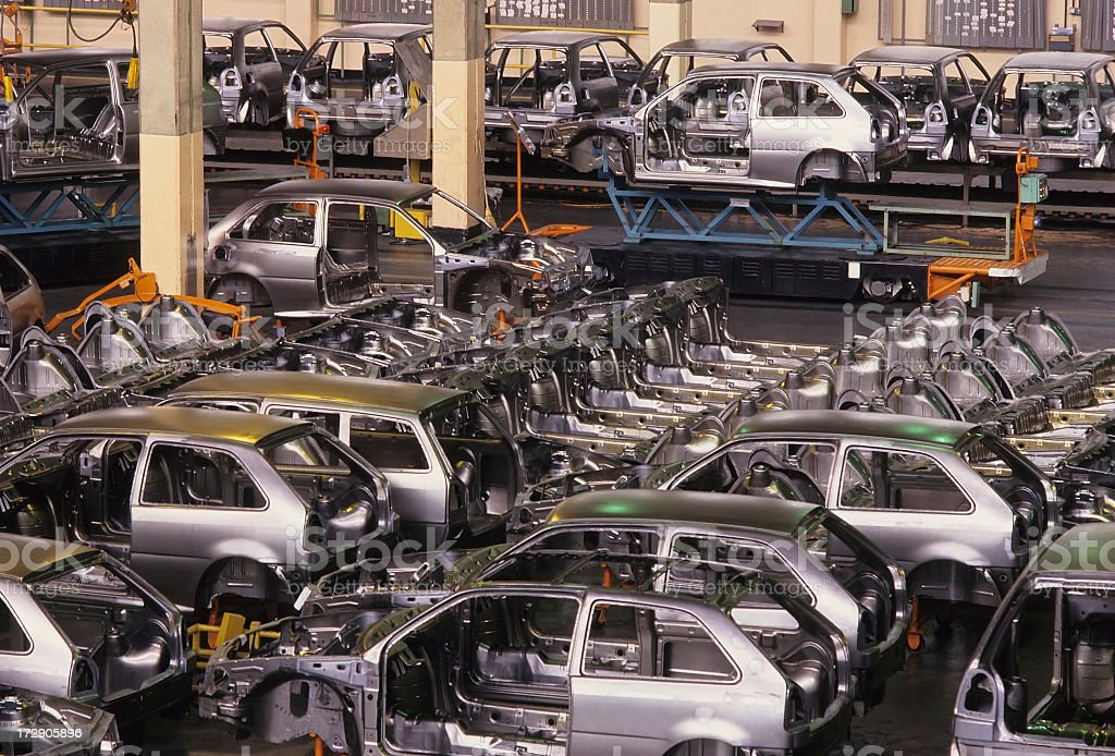 Cars on a car manufacture assembly line stock photo