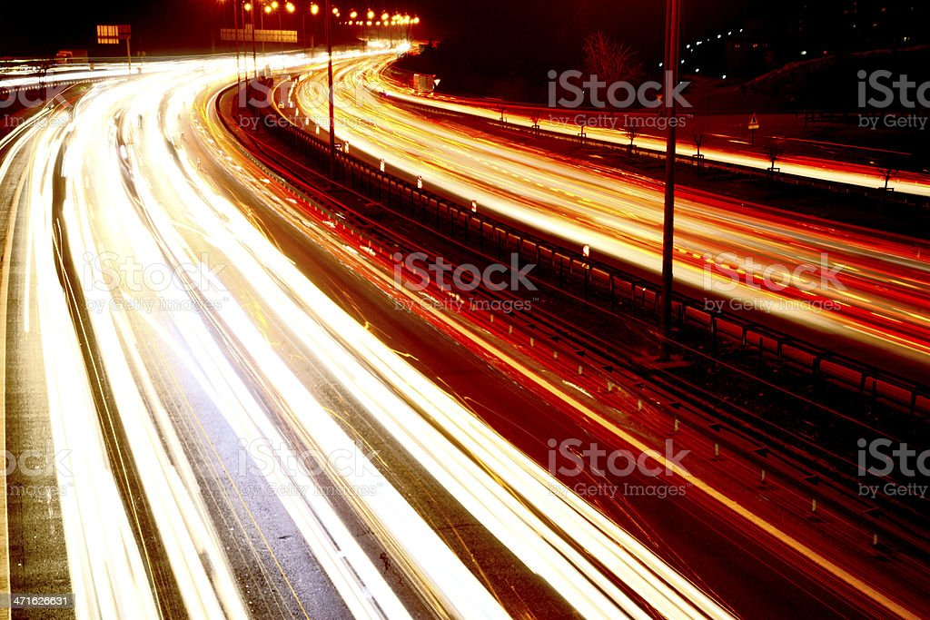 Cars on a Motorway at night stock photo