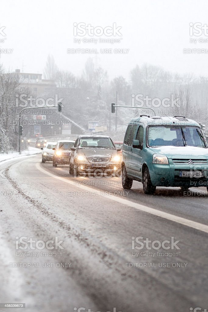 Cars on Road Moving Slowly in Winter Snowstorm royalty-free stock photo