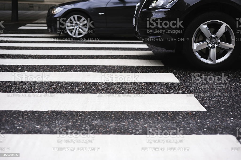 Cars on zebra crossing, a rainy day, wet asphalt royalty-free stock photo
