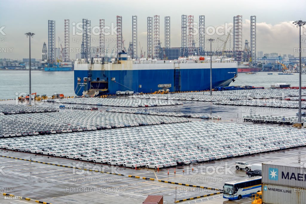 Cars parked at the Singapore port waiting to be loaded onto the ro-ro vehicles carrier stock photo