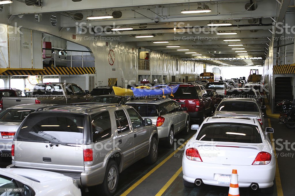 Cars parked on a ferry royalty-free stock photo