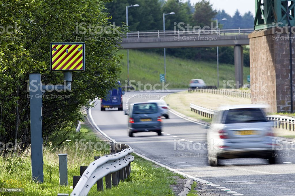Cars passing a speed camera, UK stock photo