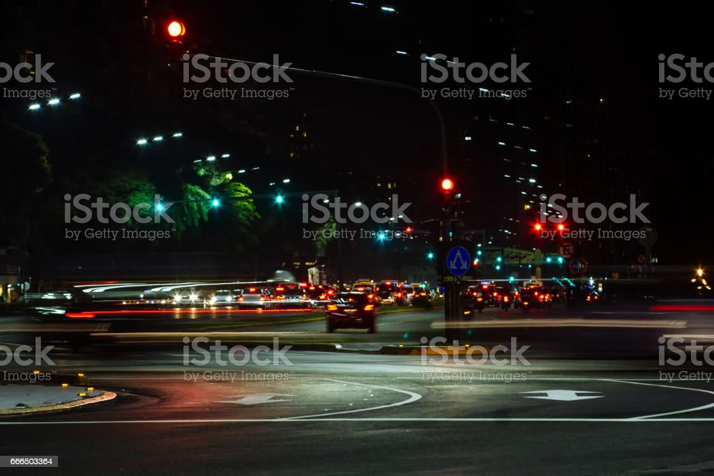 Cars passing during the night in Buenos Aires stock photo