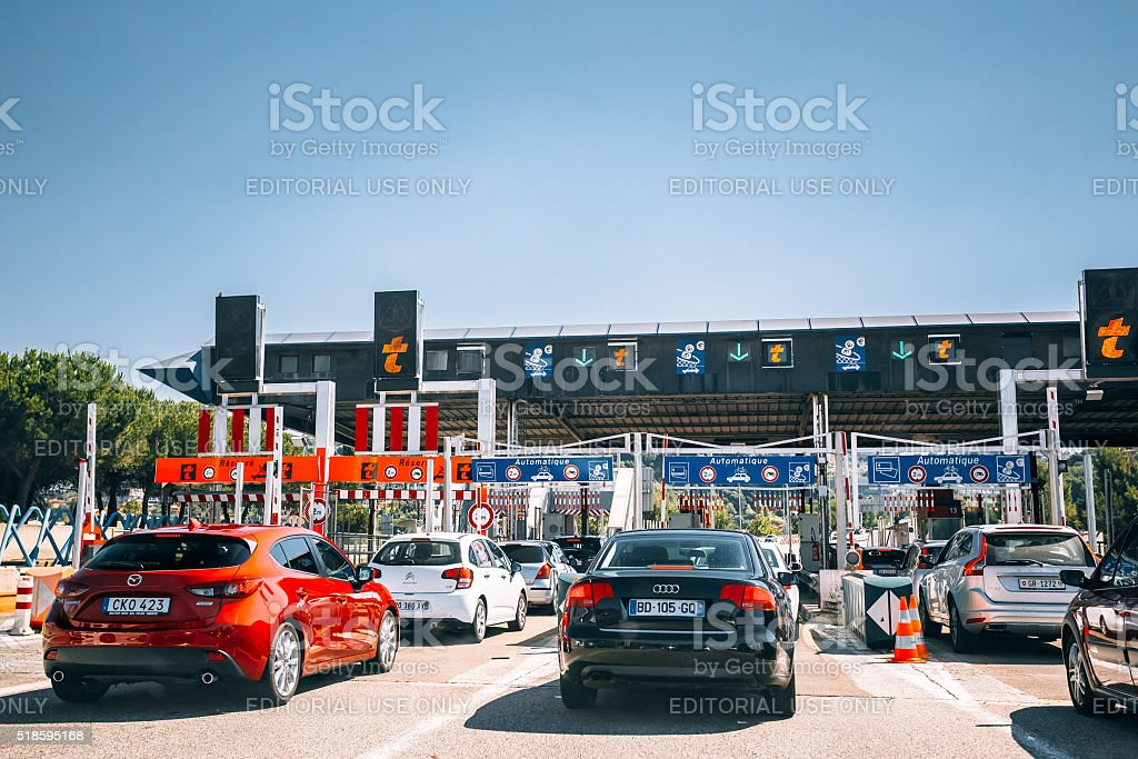 Cars passing through the point of toll highway, toll station. stock photo