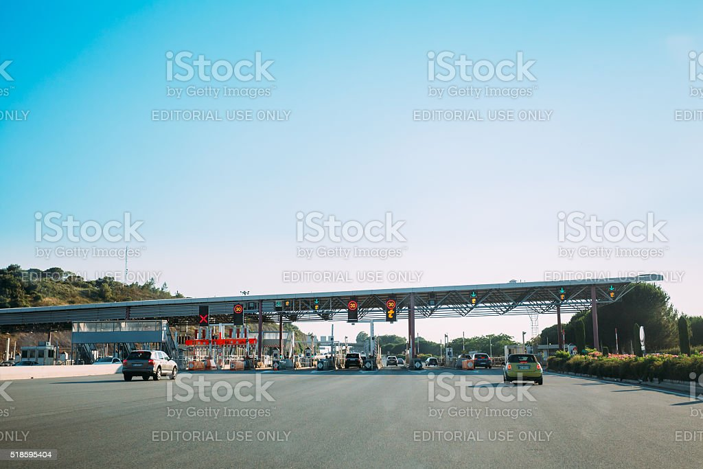 Cars passing through the point of toll highway, toll station stock photo