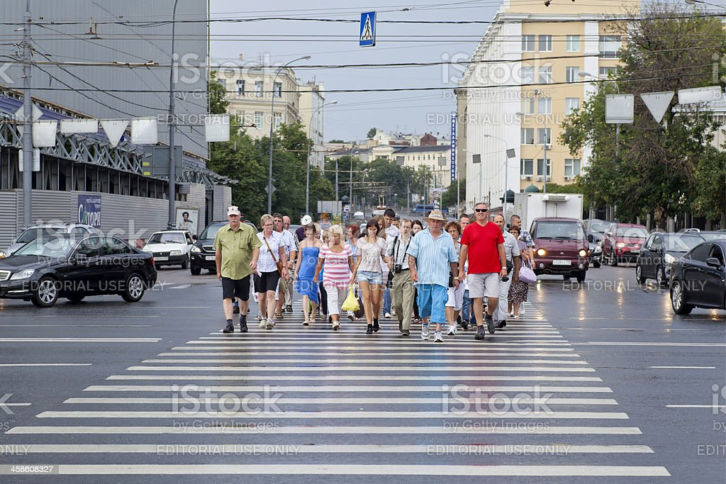 Cars, Pedestrians and a Zebra crossing royalty-free stock photo