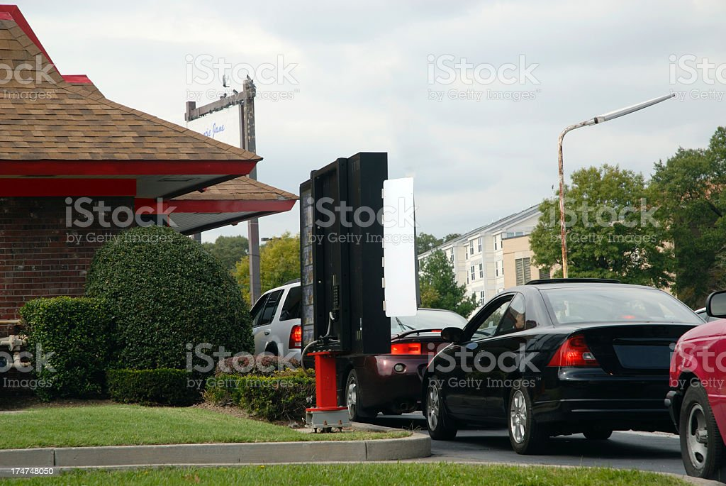 Cars queuing at a fast food drive through royalty-free stock photo