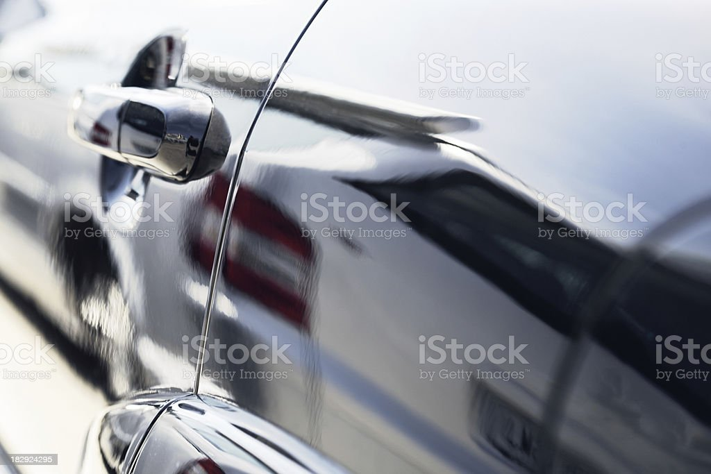 Car's reflection into another's car door _ Horizontal royalty-free stock photo