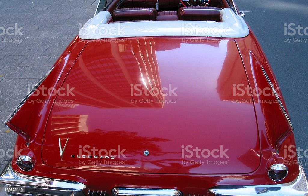 cars - reflections of a city in the duco of a caddy stock photo