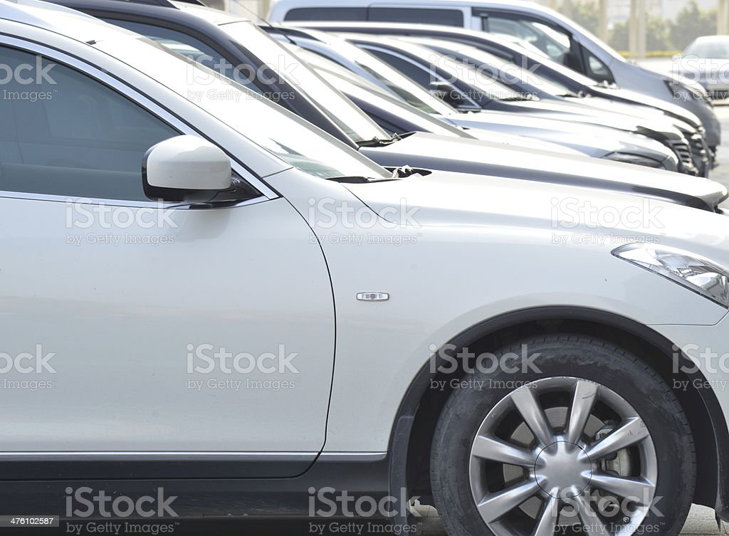 Cars row in a parking lot royalty-free stock photo