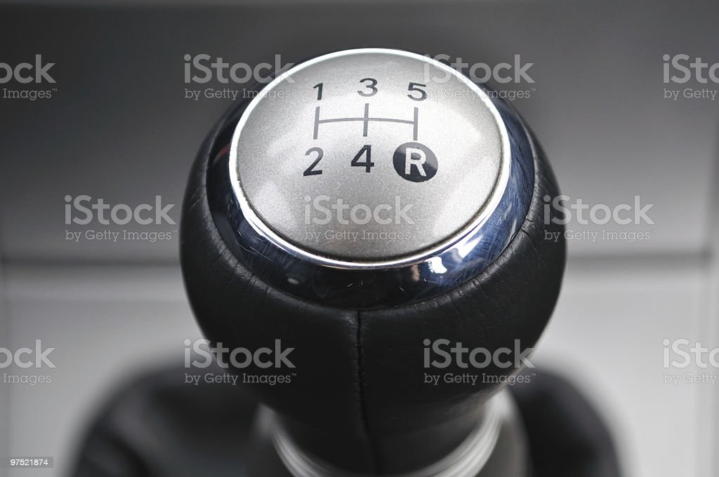 Car's shift lever. Five gears. Shiny metallic surface.Gearshift. stock photo