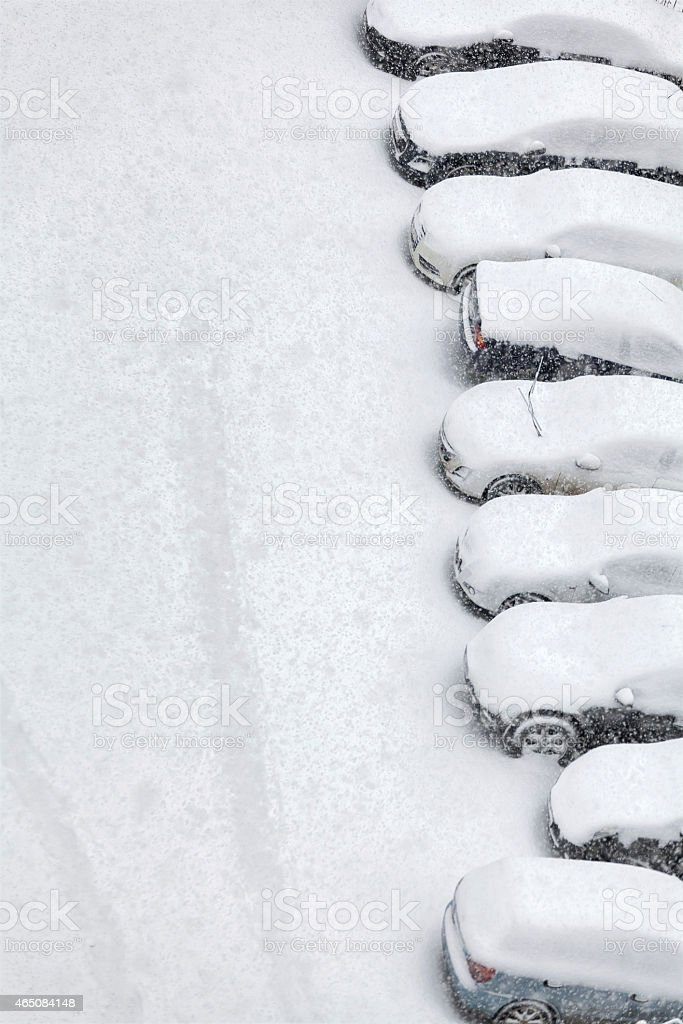 cars side by side covered with snow stock photo