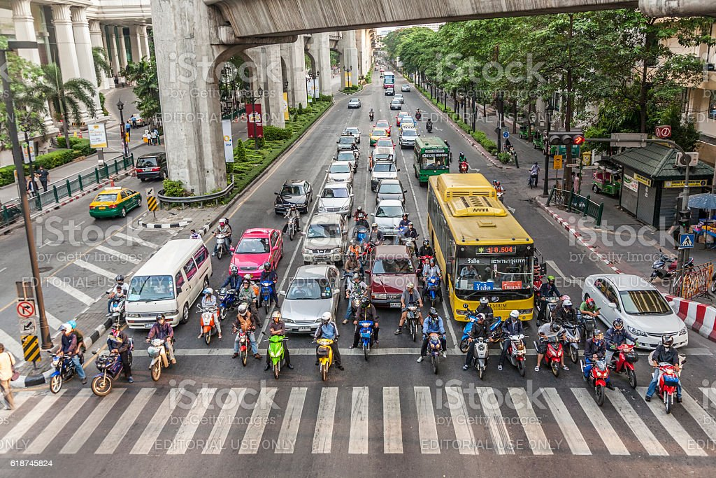 cars stop at a red traffic light  in Bangkok stock photo