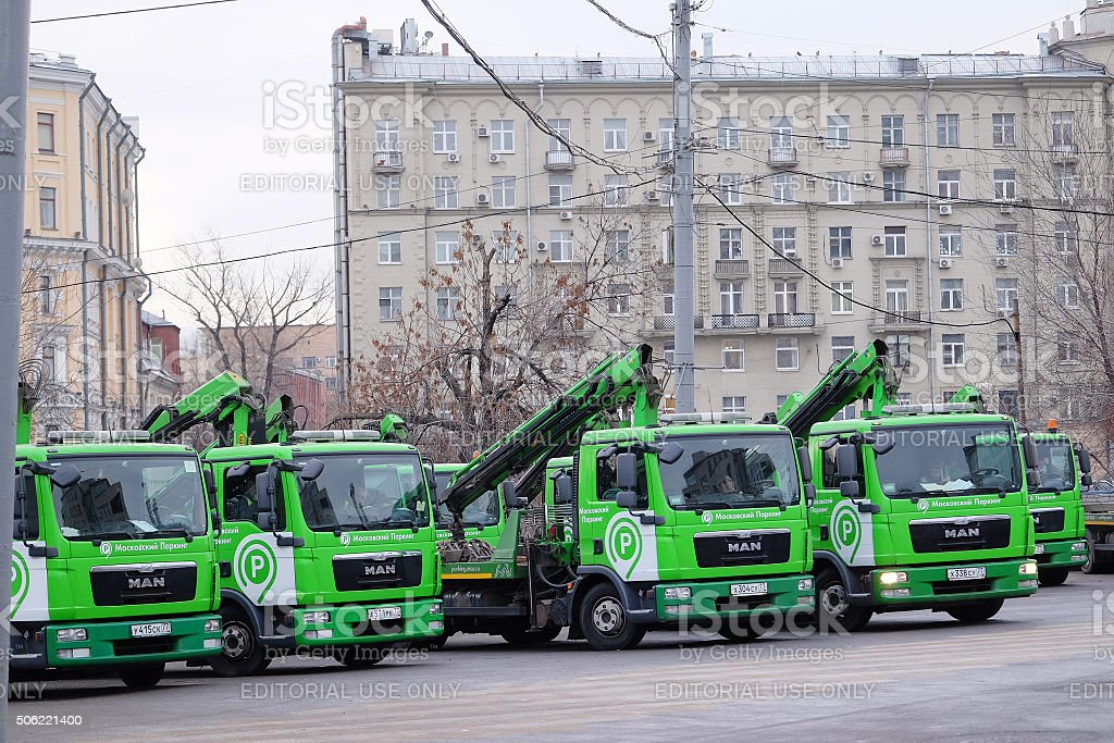 Car's tow on the street of Moscow stock photo