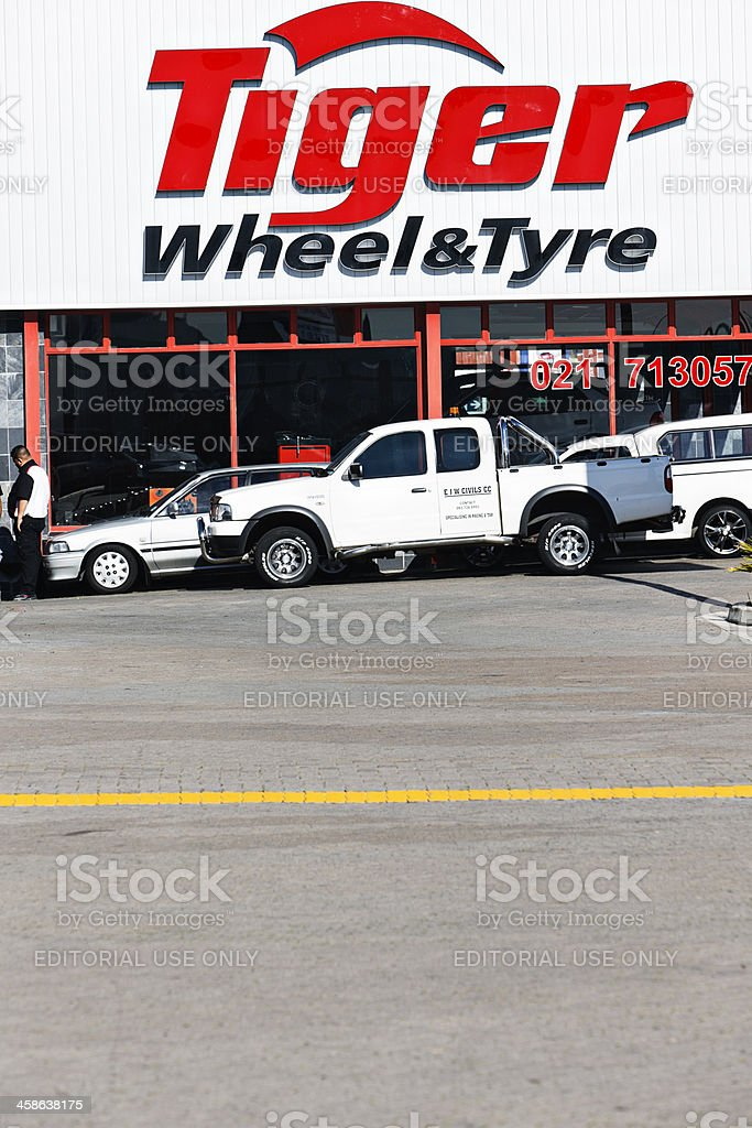 Cars waiting their turn outside Tiger Wheel & Tyre branch royalty-free stock photo