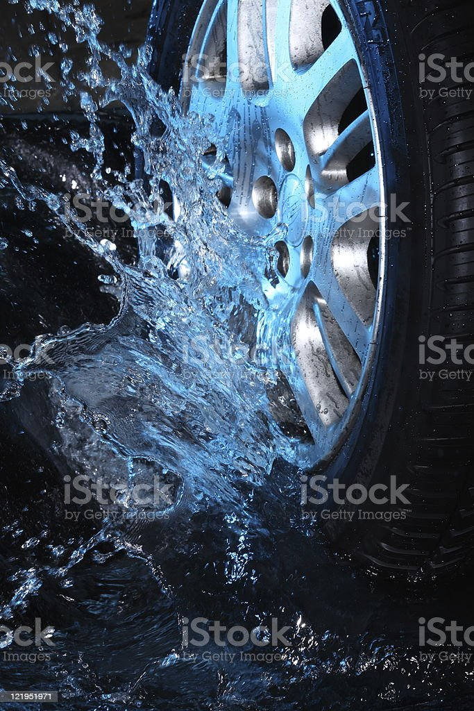 Car's wheel  with blue water stock photo