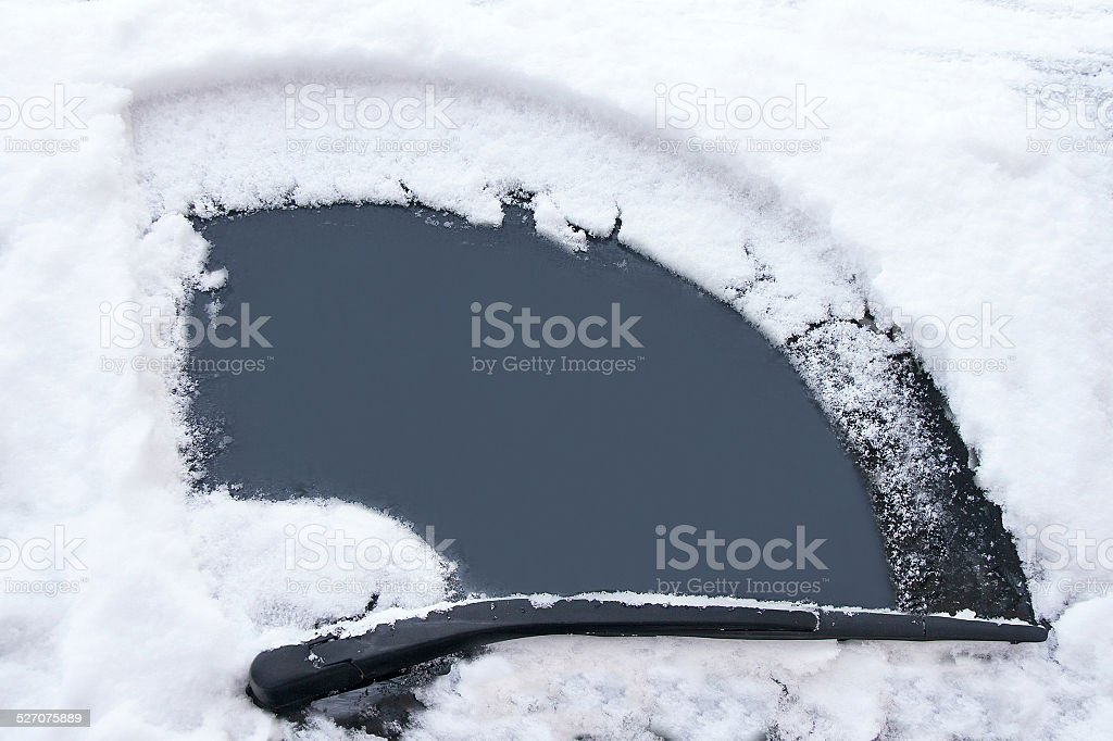 Car's window has been cleaned from snow by wipers. stock photo