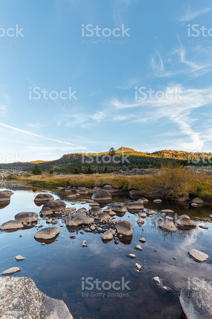 Carson river at sunset with mountains in the distance stock photo