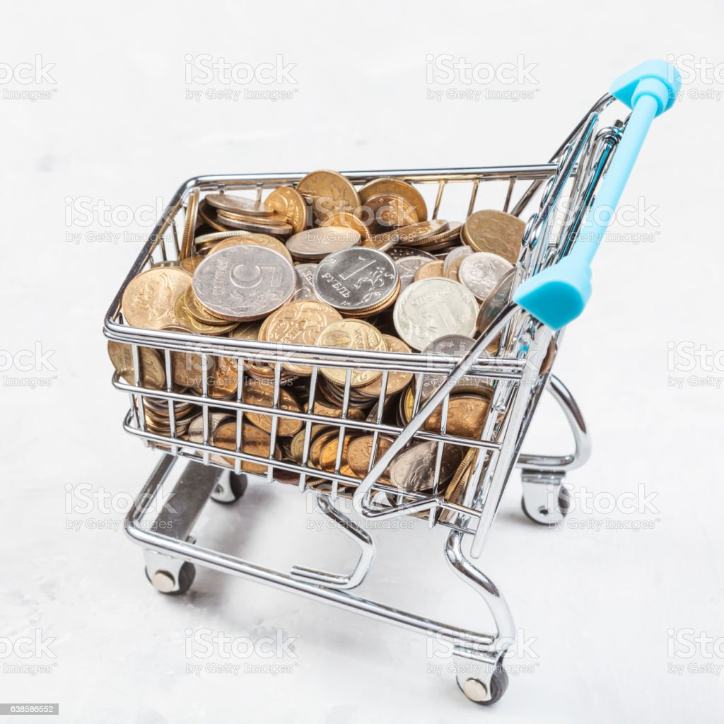 cart with russian coins on concrete plate stock photo