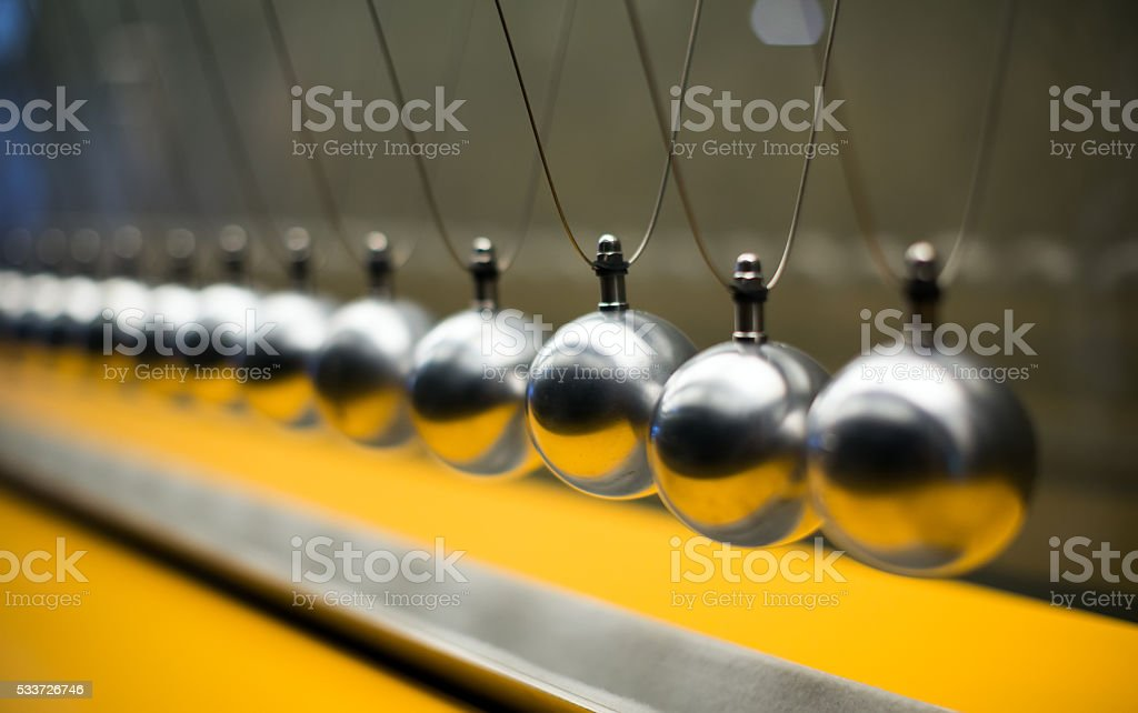 Cartesian impulse conservation law experiment with globes stock photo