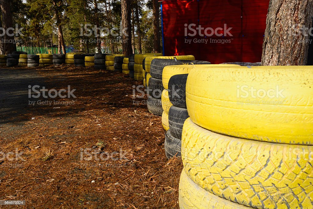 carting track made of an old painted tires stock photo