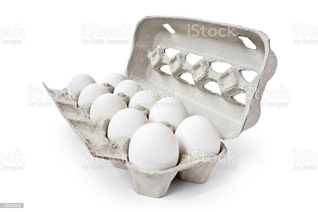Carton containing ten white eggs stock photo