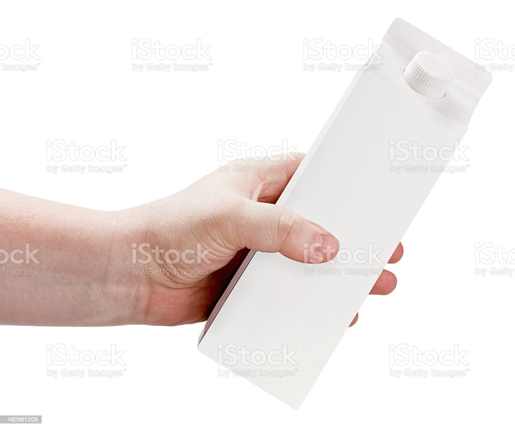 carton of milk or juice package in hand stock photo