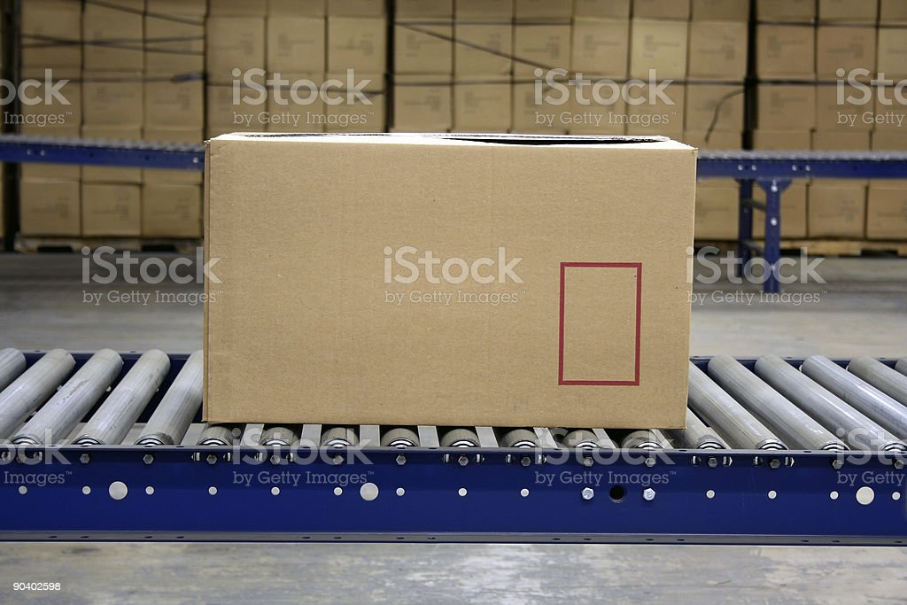 Carton on conveyor stock photo