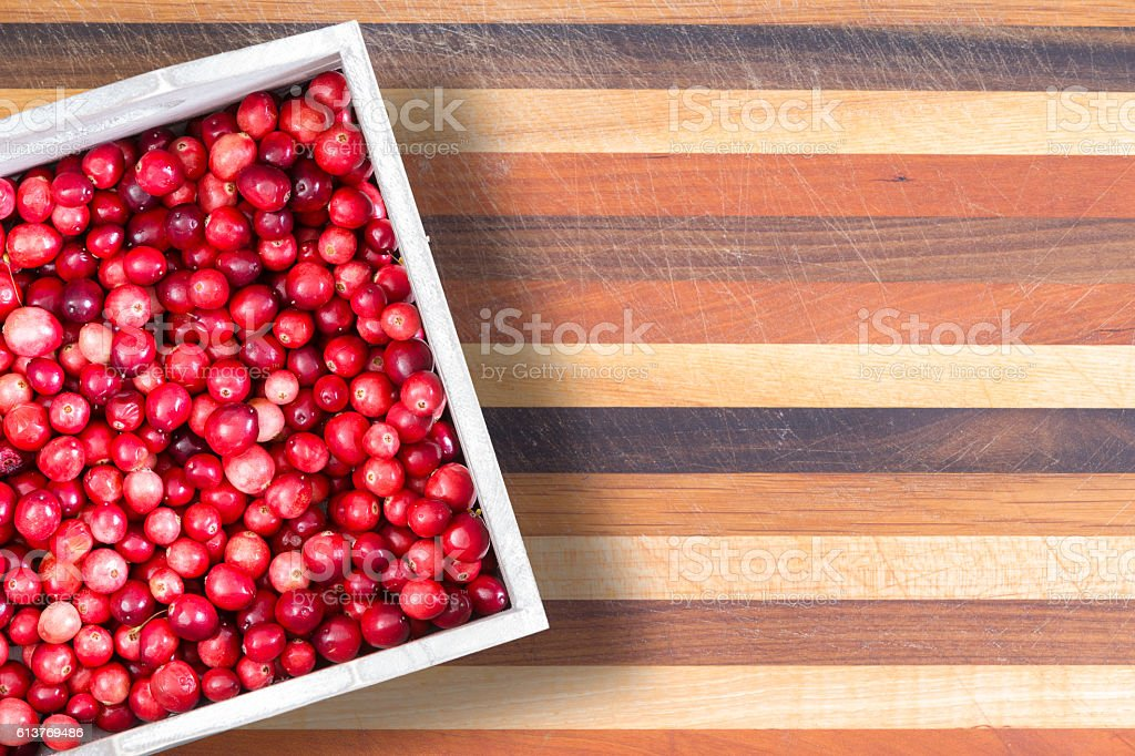 Carton or fresh ripe red sour cranberries stock photo