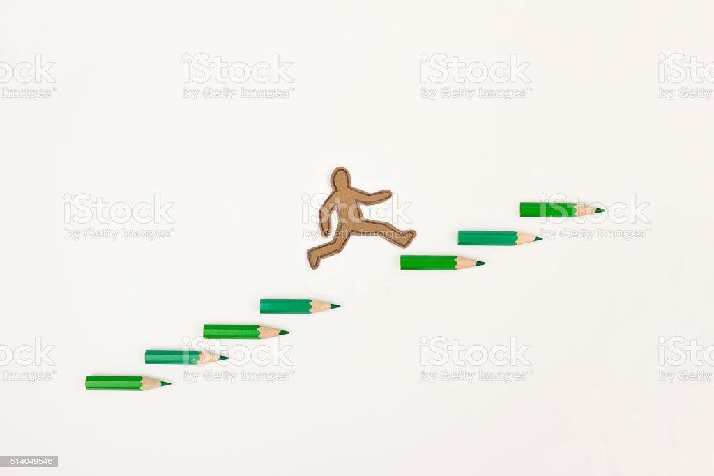 Cartoon man jumping up the career ladder stock photo