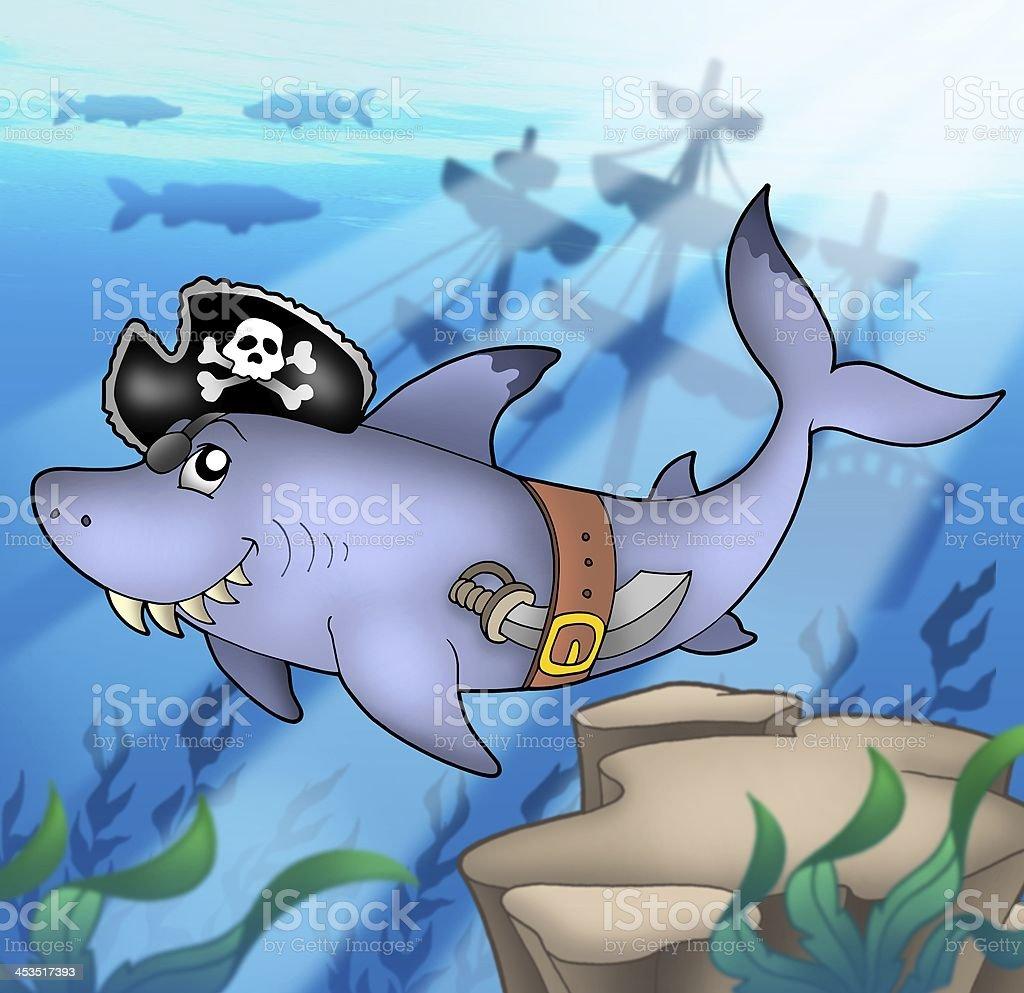 Cartoon pirate shark with shipwreck stock photo